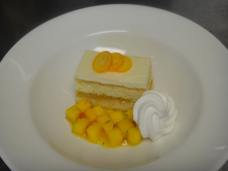 Key lime cake with lime curd and topped with lime mousse, mango salsa ...