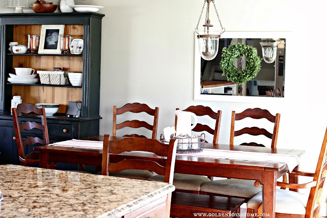 Hurricane chandelier with farmhouse hutch and boxwood wreath-www.goldenboysandme.com