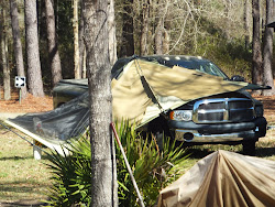 Carl's tent did finally land - on Herman's truck!