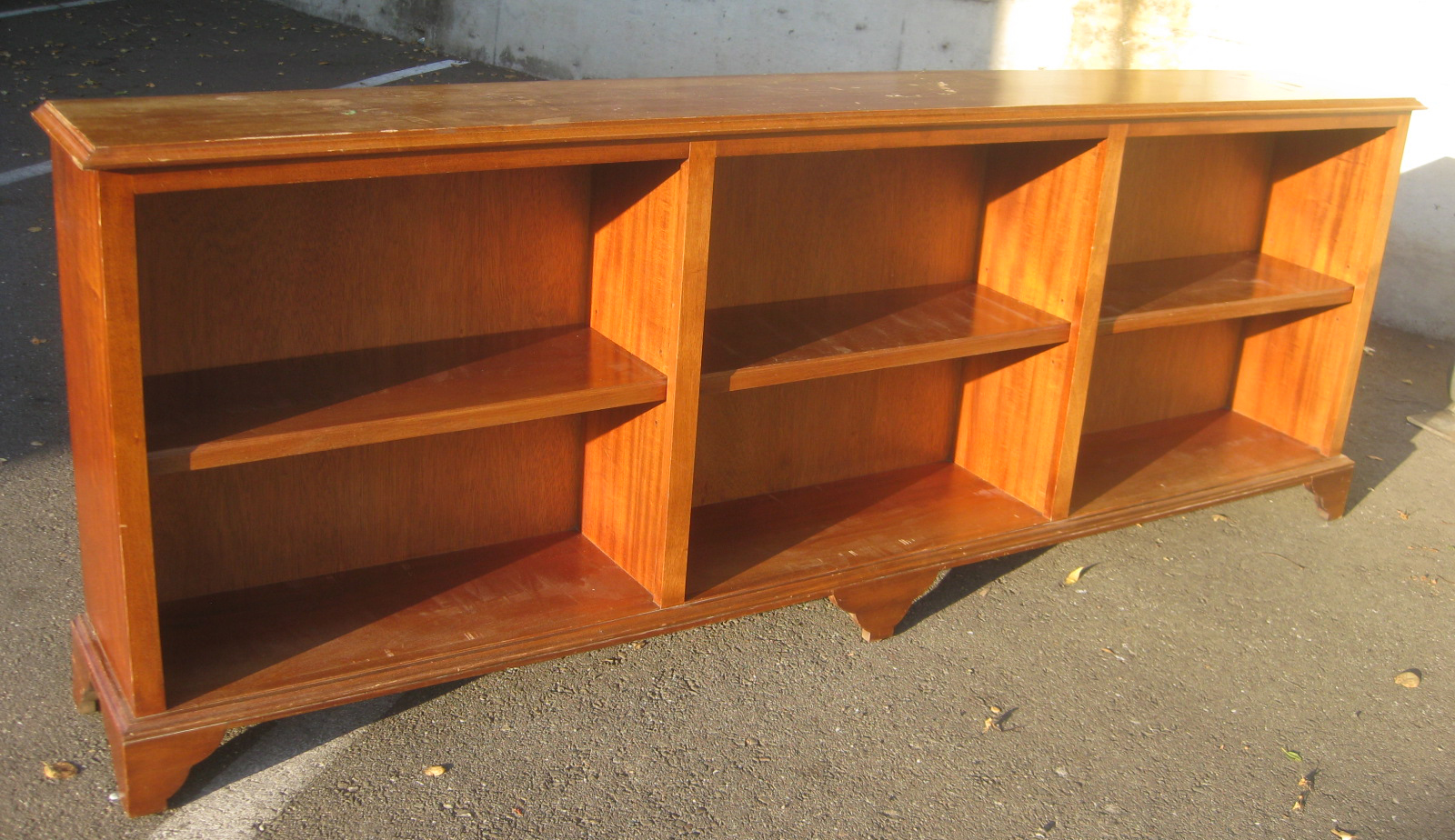 Sold long low wooden bookcase 90