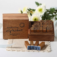 http://www.specialgiftboxes.com/product/wooden-handwritten-alphabet-stamp-set-favor/