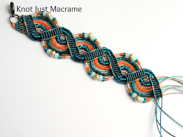 Micro macrame bracelet in progress teal with orange