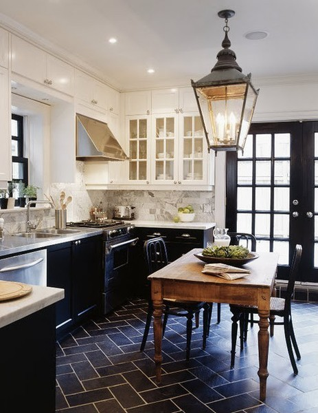 black and white cabinets white top black bottom black tile brick floor