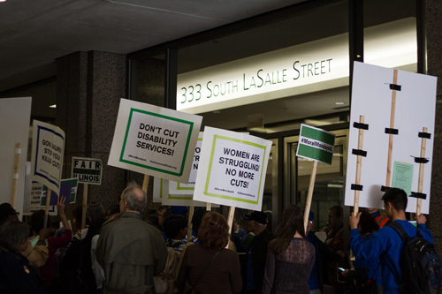 Activists protesting Gov. Bruce Rauner's proposed budget blocked the entrance to the Board of Trade on Nov. 2, 2015 (Stacy Rupolo)