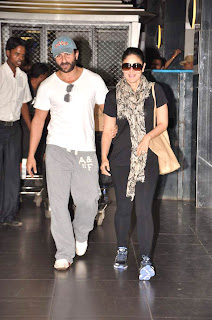 Saif Ali Khan & Kareena Kapoor return from Paris