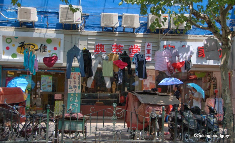 Shanghai street, washing, cycles, parasols