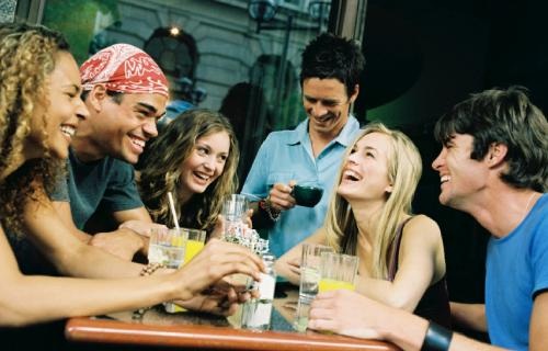 Patio Play: Flirting Al Fresco - group of people laughing dating friends
