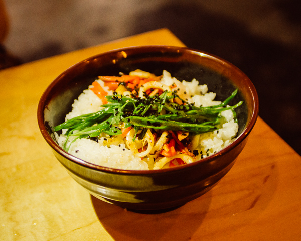 Spicy Kimchi Squid rice bowl at  Otaku South at Pop Nashville in Nashville Tennessee