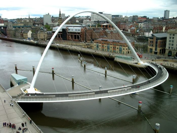 The Gateshead Millennium Bridge is a pedestrian and cyclist tilt bridge spanning the River Tyne in England between Gateshead's Quays arts quarter on the south bank, and the Quayside of Newcastle upon Tyne on the north bank. The award-winning structure was conceived and designed by architects Wilkinson Eyre and structural engineers Gifford. The bridge is sometimes referred to as the 'Blinking Eye Bridge' or the 'Winking Eye Bridge' due to its shape and its tilting method. In terms of height, the Gateshead Millennium Bridge is slightly shorter than the neighbouring Tyne Bridge, and stands as the sixteenth tallest structure in the city.