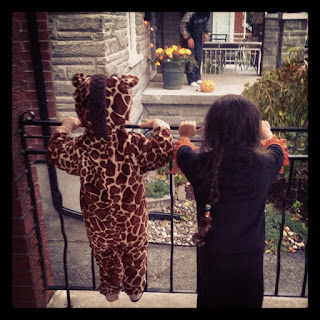 Hallowe'en, giraffe costume, children, dressed-up, dressing up, long braids, long plaits, pigtails, watching, waiting