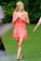Paris Hilton wearing a bright pink dress