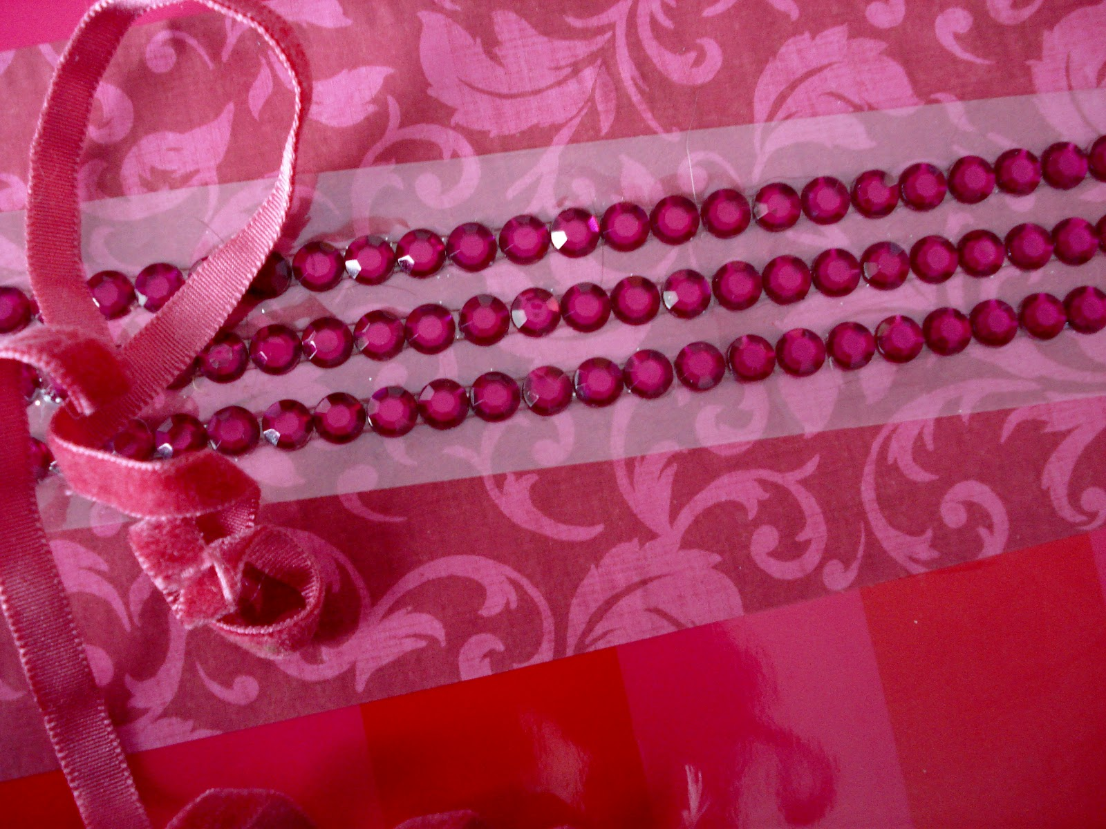 strip of hot pink rhinestone stickers, and rose colored velvet ribbon ...