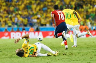 Neymar after taking a knee to the back from Zuniga