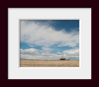 A solitary home is dwarfed by the vast space of the western prairie in the US.