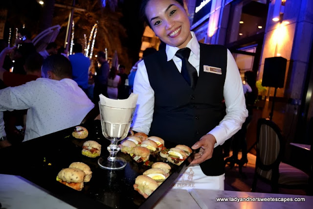 a wait staff with a tray of Fournil de Pierre's delectable sandwiches