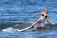 Ireland Baldwin falling off her b=paddle board