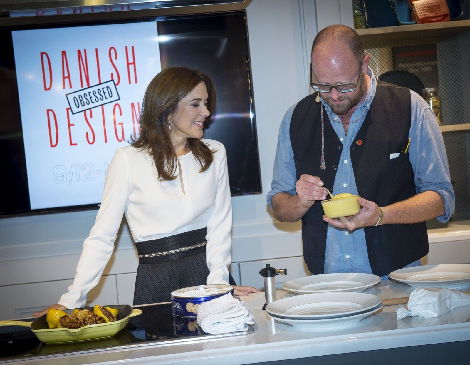"Crown Princess Mary and Paul Cunningham cooked together in connection with the opening of the ""Danish Fashion and Food Week"" in Hudson Bay, Toronto."