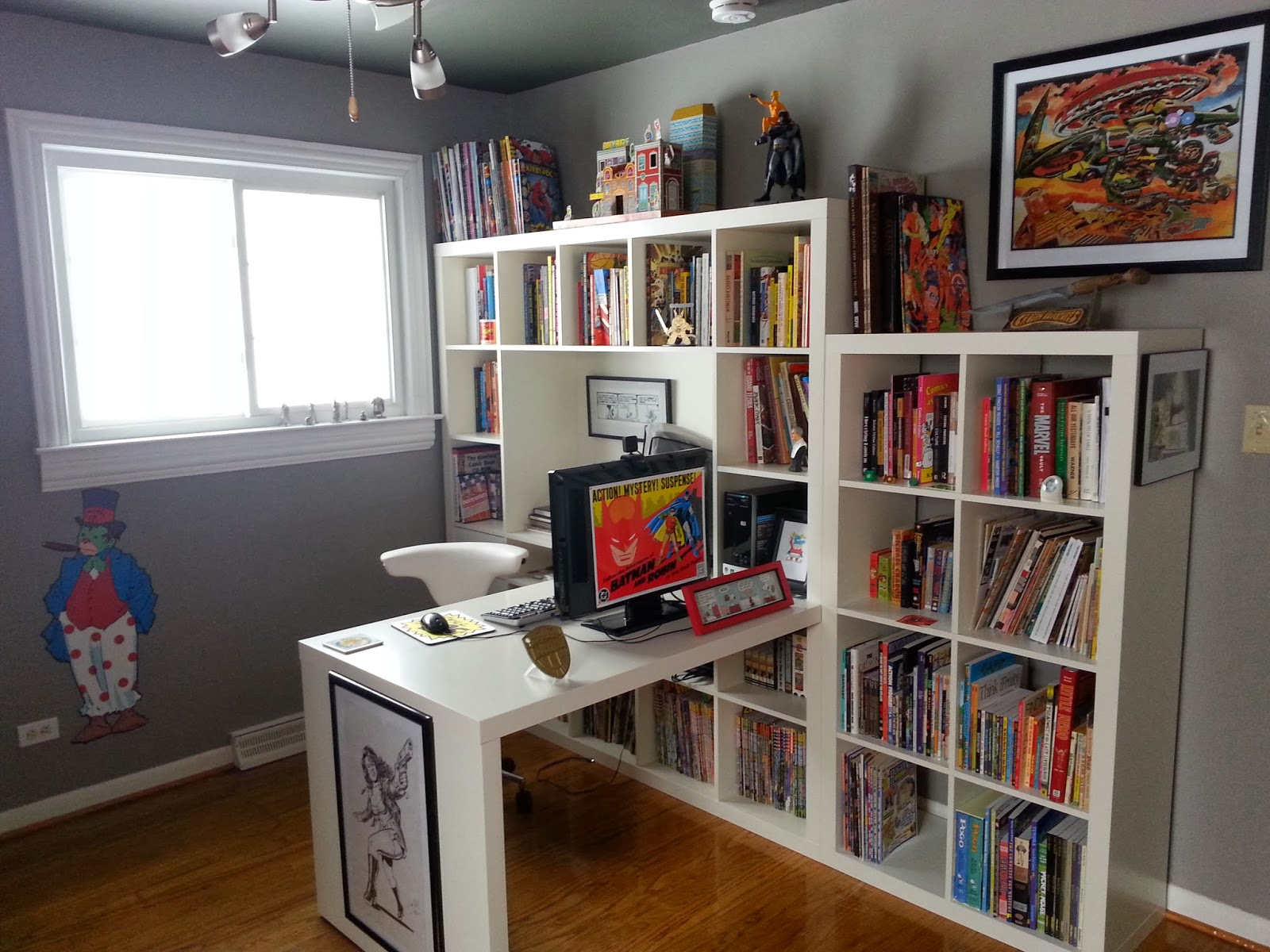 On the other side of the room is the bulk of my comics collection. The  graphic novels are stored in standard Ikea bookshelves, but I had a  carpenter build ...
