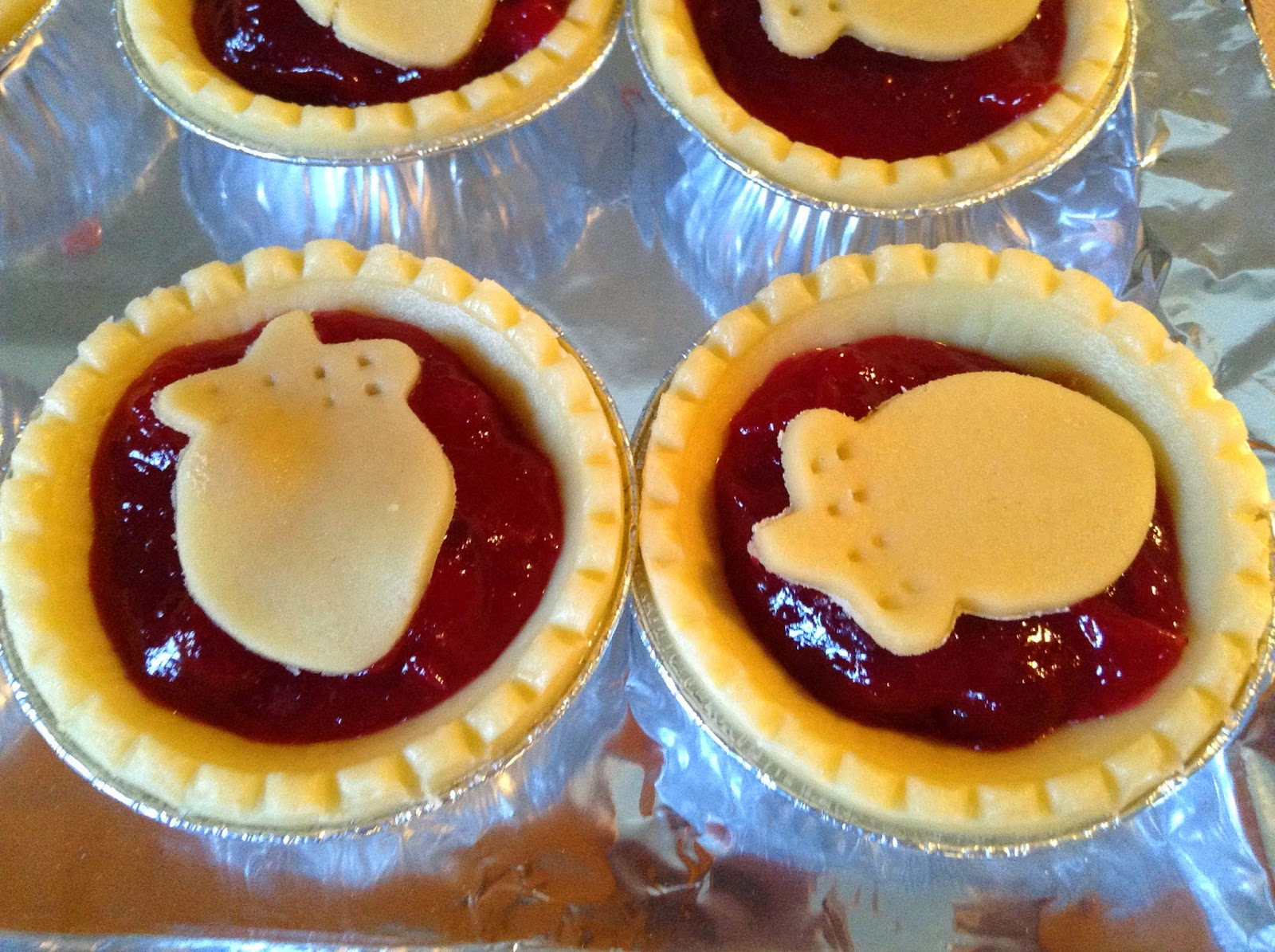 Cranberry Tarts with acorn cutouts