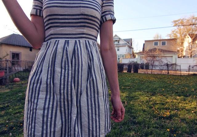 Emily in striped dress in Dollhouse backyard