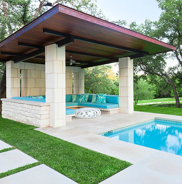 modern pool lounge area with cushions that match the pool