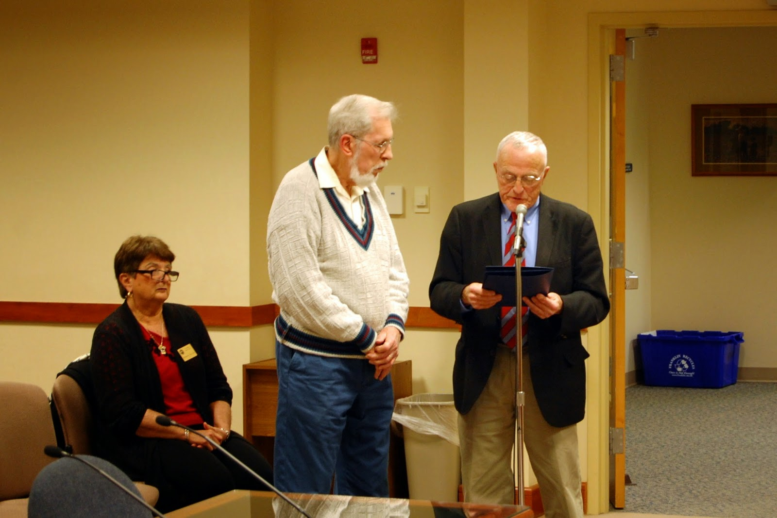 Council chair Bob Vallee with proclamation recognizing Del Arnold