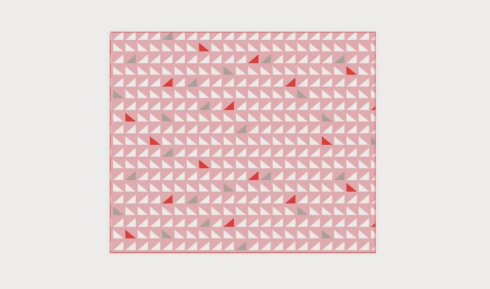 http://www.portobellostreet.es/mueble/41358/Manta-Triangulos-rosa