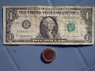the American $1 vs. the French 1