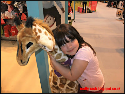 My daughter makes friend with a giant giraffe