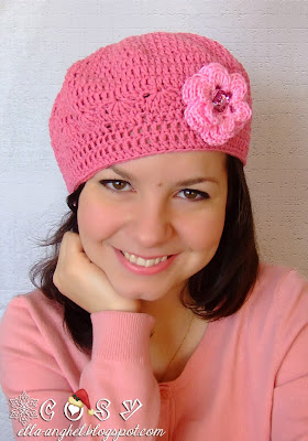 http://ella-anghel.blogspot.ro/2013/12/bascuta-crosetata-roz-bonbon.html