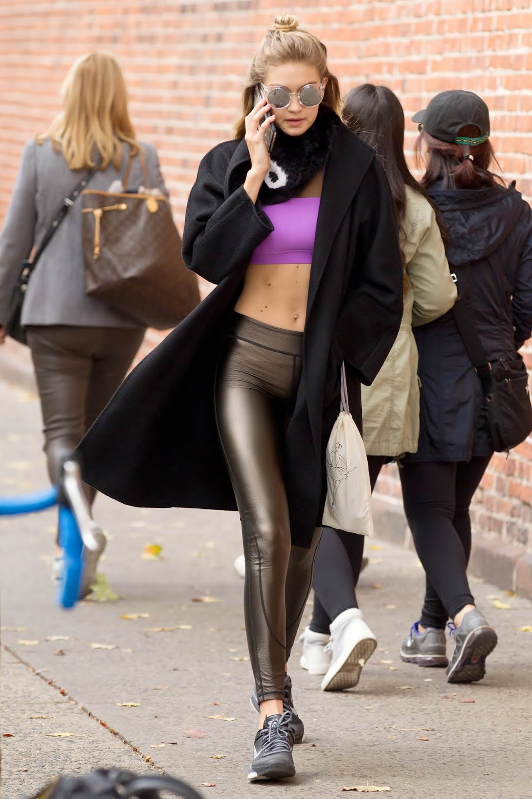 Lovely Ladies In Leather Gigi Hadid In Shiny Leggings