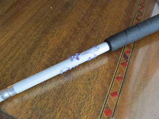 Purple rhinestones in a swirl pattern around a white cane