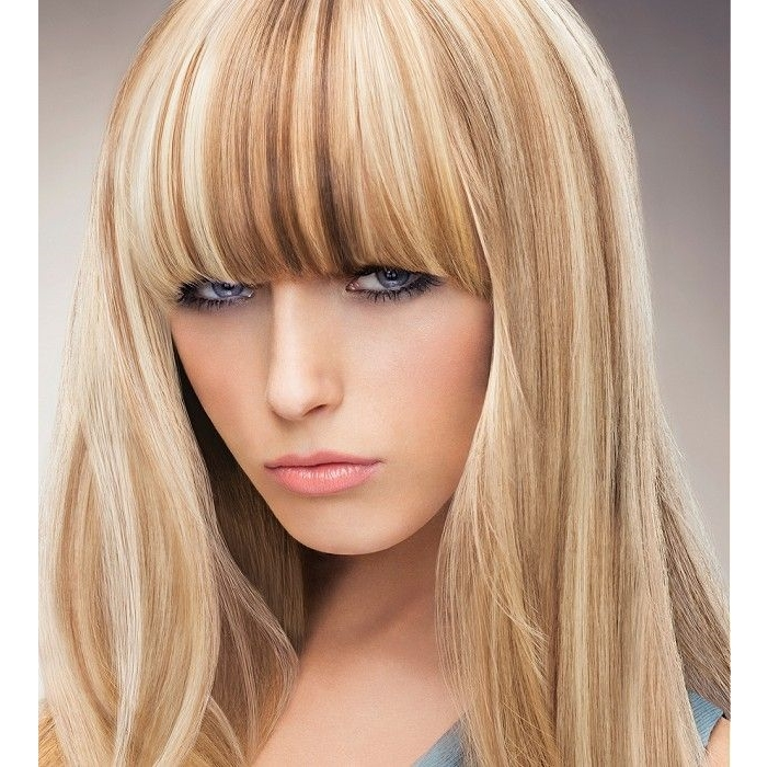 long blonde hairstyle with baleyage and blunt bangs