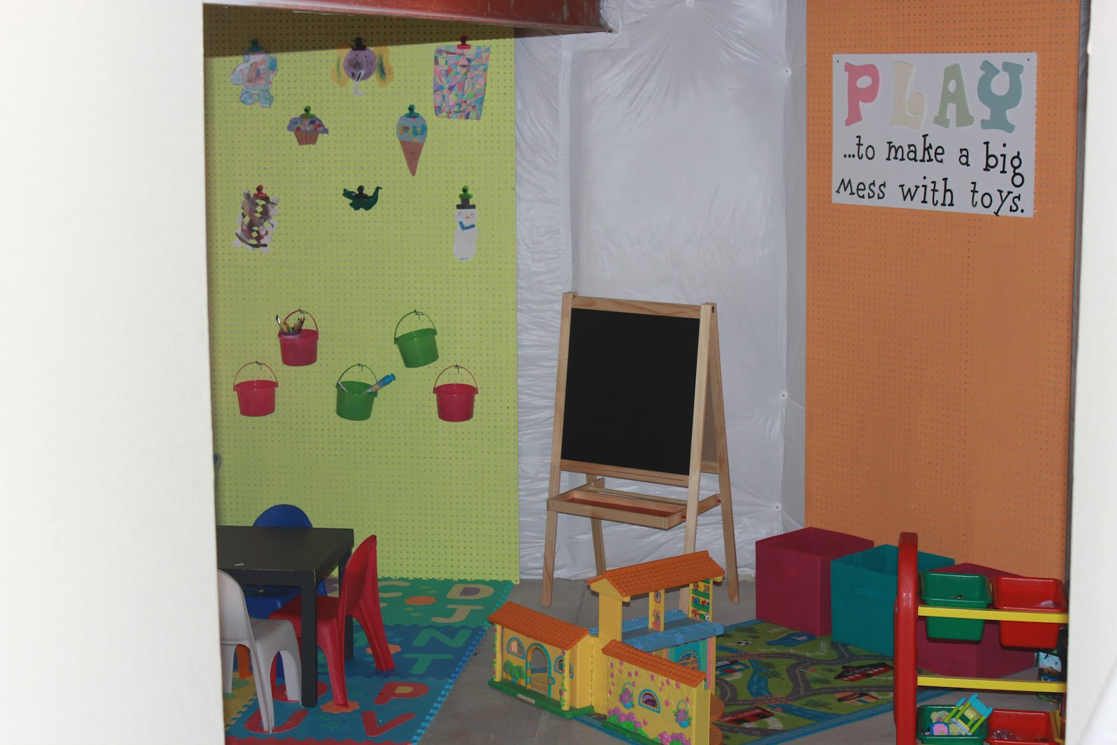 client space unfinished basement turned organized colorful playroom