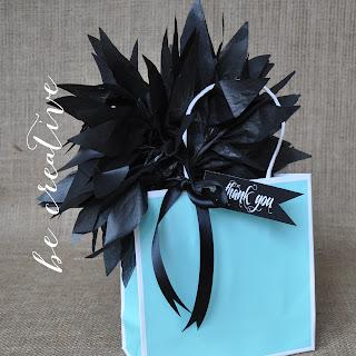 tissue paper pom pom for gift bags on Creative Bag's blog