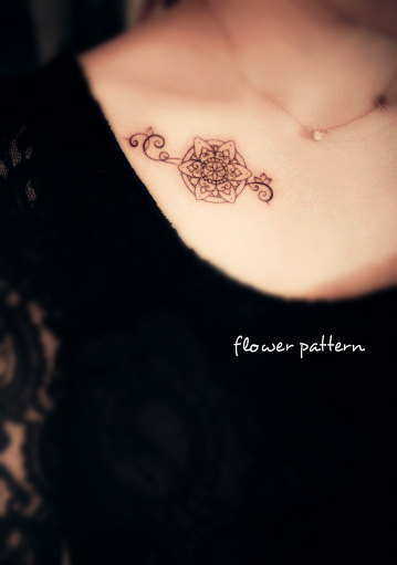 a flower pattern tattoo on the chest