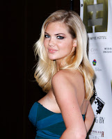 Kate Upton shows off her assets in a blue trapless dress