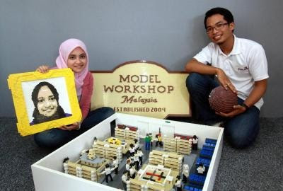 Khairunadia and Firdaus with a small-scale model of their workshop.