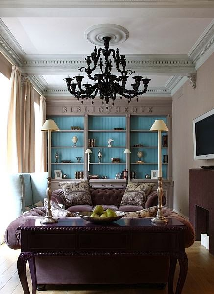 transitional library purple velvet sofa blue bookcases black chandelier