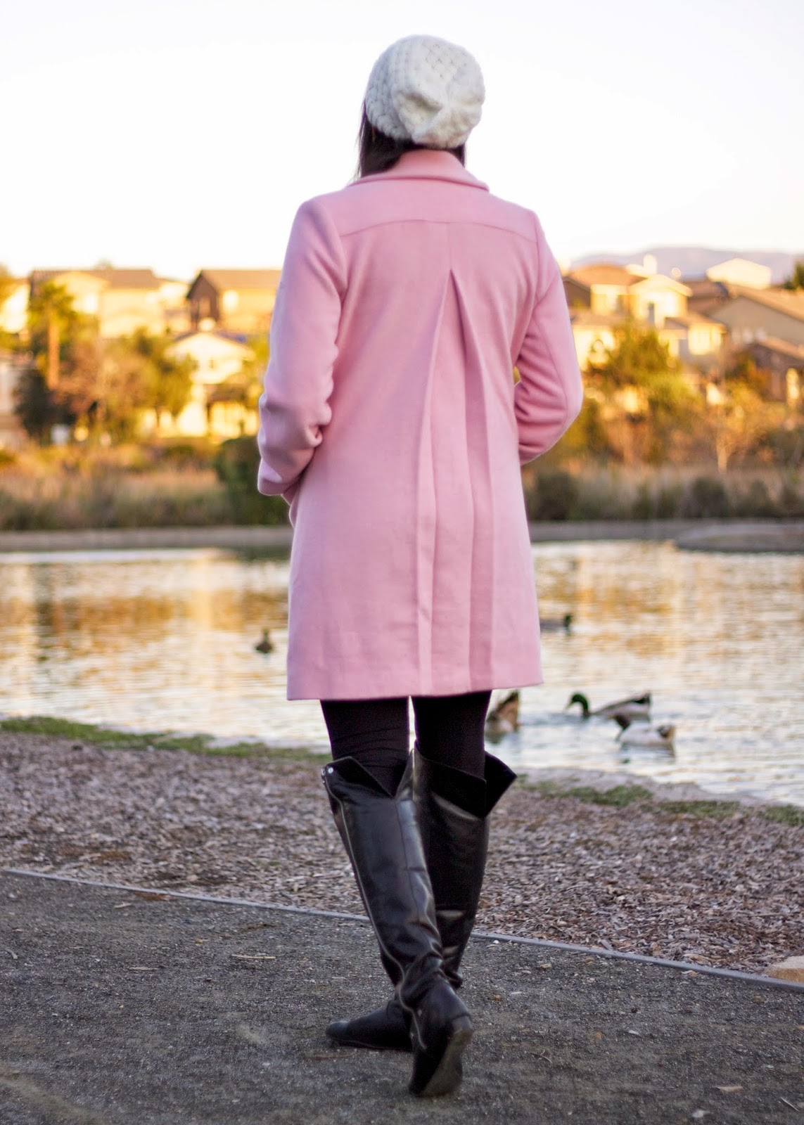 over the knee boots, pink coat with black bottoms, black leggings outfit, beanie with coat, ways to wear a pink coat, wear stripes, chic stripes, how to wear stripes chic, chic 2015