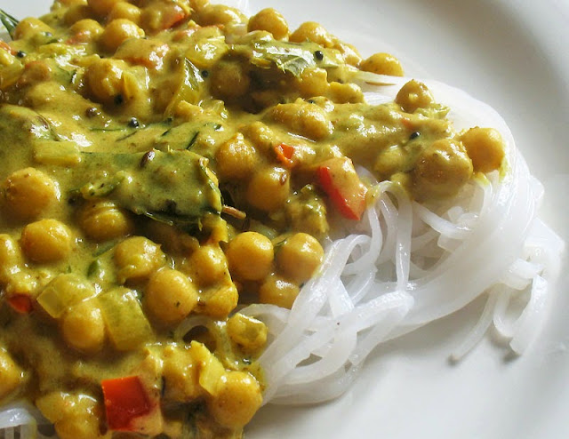 tamarind chickpeas over rice noodles