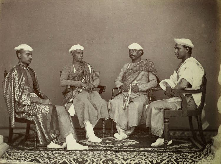 Group Portrait of four seated men, described as Bankers Delhi - 1863