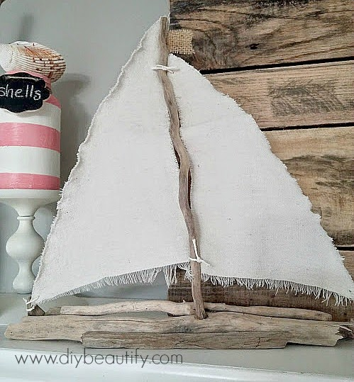 DIY driftwood and dropcloth sailboat www.diybeautify.com