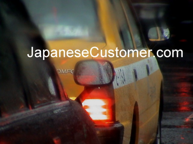 Japanese taxi in rain tokyo, copyright peter hanami 2005