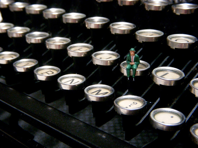 typewriter keys small man