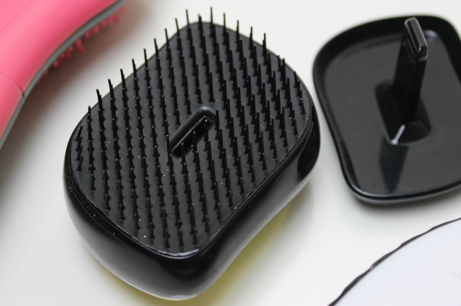 A picture of Tangle Teezer Metallic Gold Rush Compact Styler Instant Detangling Brush