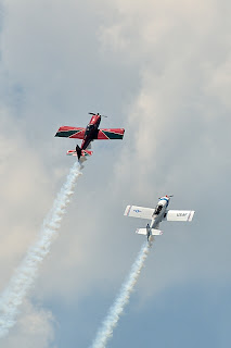 picture of Mike Stewart and Jerry Morris from Team RV at the Evansville Freedom Festival flying in close formation