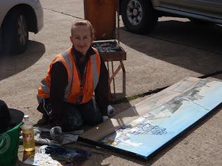 Jane Bennett industrial heritage artist painting ex HMAS Adelaide en plein air on Glebe Island Wharf