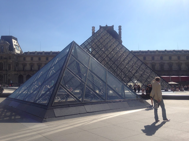 France Paris holiday visiting the louvre museum pyramids sunny day