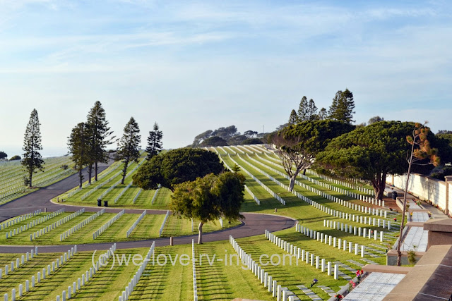 Rows and rows of white headstones show the final resting places of thousands of veterans